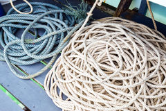 Rope on the boat. To use for tied with a cleat at harbor, sometime it`s use for drag the other boat, rescue and hold something etc Royalty Free Stock Image
