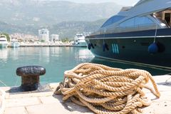 Rope and bollard on pier Stock Photography