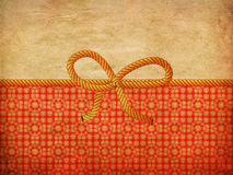 Rope bow on decorative background Stock Images