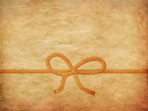 Rope bow on paper Royalty Free Stock Photography