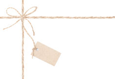 Rope bow tag . Jute wrapping  for present and pricing. Close up. Royalty Free Stock Photography