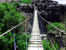 Rope bridge. A rope bridge leading over a canyon royalty free stock photo