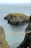 Rope bridge. The spectacular and famous rope bridge of Carrick-a-Rede in Northern Ireland Royalty Free Stock Photos