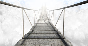 Rope Bridge Above The Clouds. A rope bridge made of wooden planks held together by rope and secured by wooden pegs above the clouds in the heavens Royalty Free Stock Photography