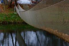 Rope bridge above the river stock photos