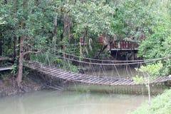 Rope bridge  across river Stock Photo