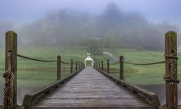 Rope Bridge Across. A lake at a private golf cours in Highlands North Carolina Royalty Free Stock Photo