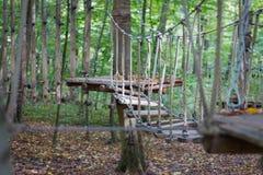 Rope bridge at adventure climbing park royalty free stock photography