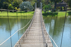 Rope bridge. A  is a bridge constructed chiefly of rope. In its simplest form, it can be one or two ropes that bridge a river Royalty Free Stock Photography