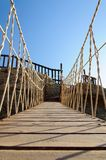 Rope bridge made of wooden planks Stock Photos