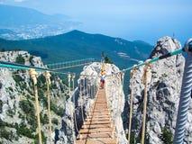 The rope bridge on Mount Ai-Petri. The rope bridge between the peaks of Mount Ai-Petri stock photography