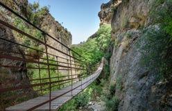 Rope bridge over a canyon in Cahorros, Granada, Royalty Free Stock Photos