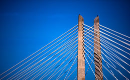 Rope bridge piers stretching on blue sky background Royalty Free Stock Image