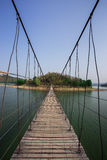Rope bridge to the island Royalty Free Stock Photos