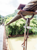 Rope bridge. The ways to across the river in some of the travel place or jungle , popular for extreme adventure travel Royalty Free Stock Photo