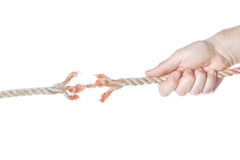 The rope is broken in the men's hands. Stock Images