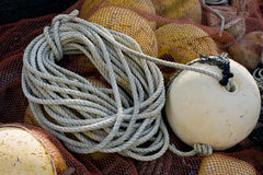 Rope with Buoy Attached. Worn and weathered Rope with Buoy attached stock photos