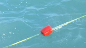 Rope buoy in the sea stock footage