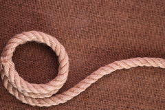 Rope on Burlap Stock Photography