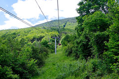 Rope chairlift. Climbing up the mountain with rope chairlift Royalty Free Stock Images