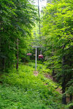 Rope chairlift. Climbing up the mountain with rope chairlift Stock Photo