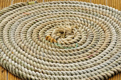 A rope in circles on a boat. A rope in circles on te wooden deck of a boat royalty free stock photo