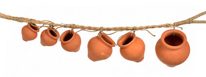 Rope with clay pots Stock Photography