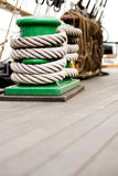 Rope on cleat schooner deck. Rope wrapped around cleat of large old schooner Stock Images