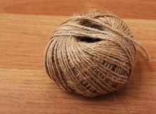 Rope clew. Clew of rope on a brown table Royalty Free Stock Photos