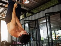 Rope Climb Exercise at fitness gym Stock Image