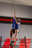 Rope Climb exercise man workout at gym. Climbing Royalty Free Stock Photo