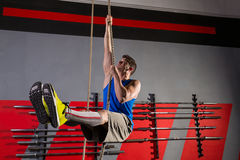 Rope Climb exercise man workout at gym Royalty Free Stock Photos