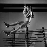 Rope Climb exercise woman workout at gym Royalty Free Stock Image