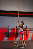 Rope Climb exercise woman workout at gym Stock Photos