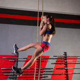 Rope Climb exercise woman workout at gym Royalty Free Stock Images
