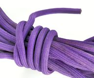 Rope for climbing. Close up of nylon rope for climbing on a white background stock image