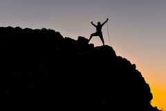 Rope climbing success. Adrenaline,discovery and brave Royalty Free Stock Images