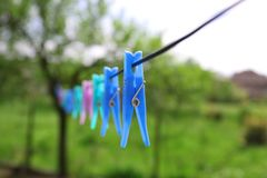 Rope with clothespin on green landscape background. royalty free stock images