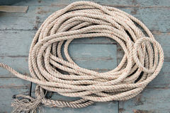 Rope coil on aged wooden boat. Top view Stock Images