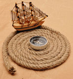 Rope coil with compass Royalty Free Stock Photos