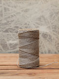Rope coil on old wooden background Stock Images