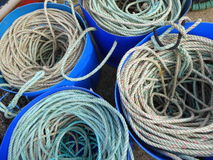 Rope coils in plastic tubs Royalty Free Stock Photography