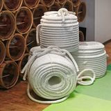 Rope Coils. Thick New White Ropes Rolled in Coils royalty free stock photo