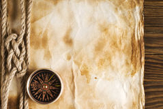 Rope and compass on the old paper. Background Stock Photos