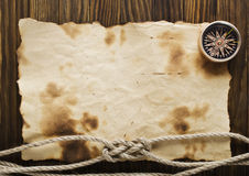 Rope and compass on the old paper. Background Stock Photography