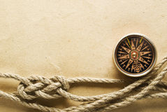 Rope and compass on the old paper Royalty Free Stock Photos
