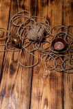 Rope and copper utensils on old wooden burned table or board for Stock Images