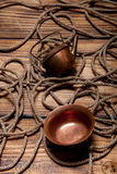 Rope and copper utensils on old wooden burned table or board for Stock Photography
