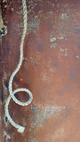 Rope on corroded metal Royalty Free Stock Image