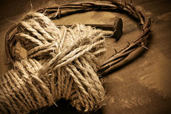 Rope cross, crown of thorns and nails. Closeup of a representation of the Jesus Christ crown of thorns and nail, and a rope cross Stock Images